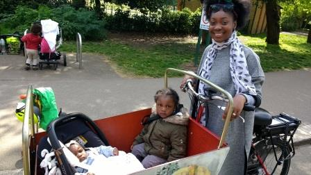 Mum with baby and toddler in cargobike Trike